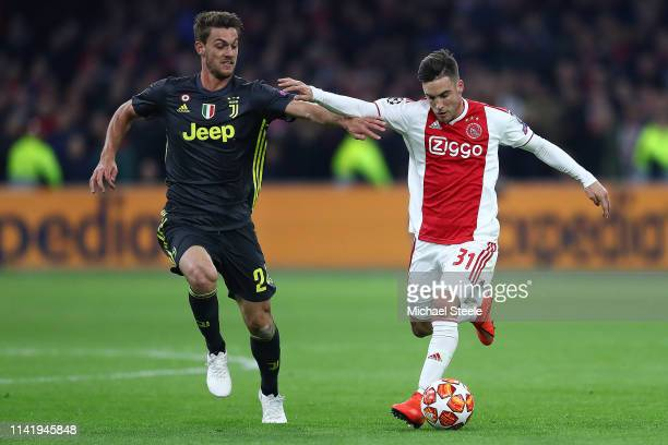 Nicolas Tagliafico of Ajax challenged by Daniele Rugani of Juventus during the UEFA Champions League Quarter Final first leg match between Ajax and...