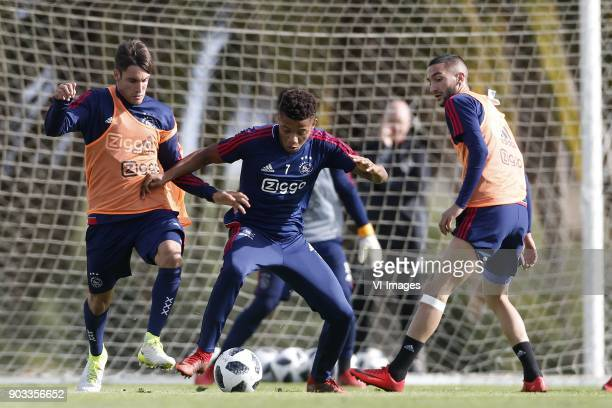 Nicolas Tagliafico of Ajax David Neres of Ajax Hakim Ziyech of Ajax during a training session of Ajax Amsterdam at the Cascada Resort on January 10...