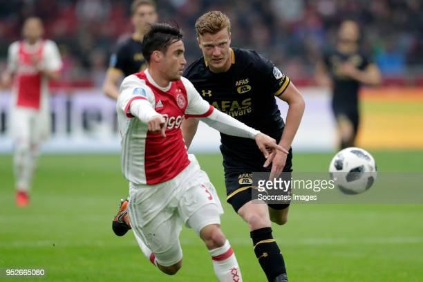 Nicolas Tagliafico of Ajax Ferdy Druijf of AZ Alkmaar during the Dutch Eredivisie match between Ajax v AZ Alkmaar at the Johan Cruijff Arena on April...