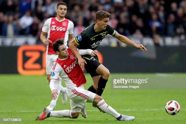 Nicolas Tagliafico of Ajax Guus Til of AZ Alkmaar during the Dutch Eredivisie match between Ajax v AZ Alkmaar at the Johan Cruijff Arena on October 7...