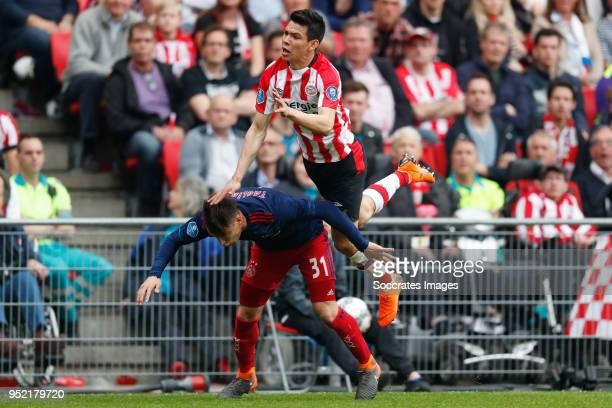 Nicolas Tagliafico of Ajax Hirving Lozano of PSV during the Dutch Eredivisie match between PSV v Ajax at the Philips Stadium on April 15 2018 in...