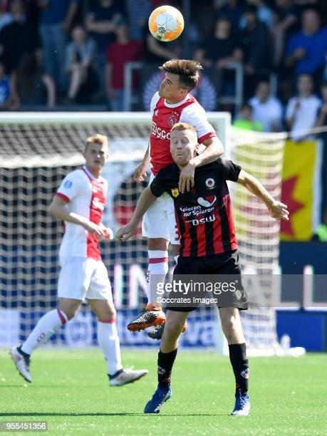 Nicolas Tagliafico of Ajax Mike van Duinen of Excelsior during the Dutch Eredivisie match between Excelsior v Ajax at the Van Donge De Roo Stadium on...