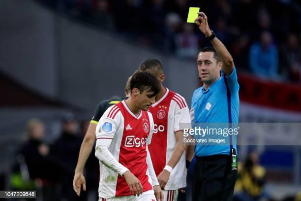 Nicolas Tagliafico of Ajax receives a yellow card from referee Dennis Higler during the Dutch Eredivisie match between Ajax v AZ Alkmaar at the Johan...
