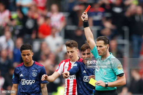 Nicolas Tagliafico of Ajax referee Danny Makkelie during the Dutch Eredivisie match between PSV v Ajax at the Philips Stadium on April 15 2018 in...