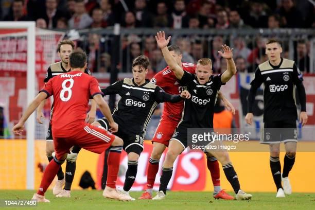 Nicolas Tagliafico of Ajax Robert Lewandowski of Bayern Munchen Dani de Wit of Ajax during the UEFA Champions League match between Bayern Munchen v...