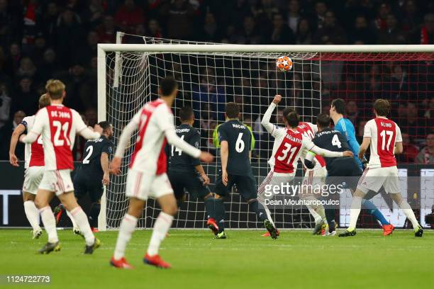 Nicolas Tagliafico of Ajax scores his team's first goal but it is later rulled out by the VAR during the UEFA Champions League Round of 16 First Leg...