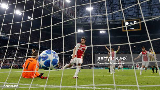 Nicolas Tagliafico of Ajax scores his team's first goal during the Group E match of the UEFA Champions League between Ajax and AEK Athens at Johan...