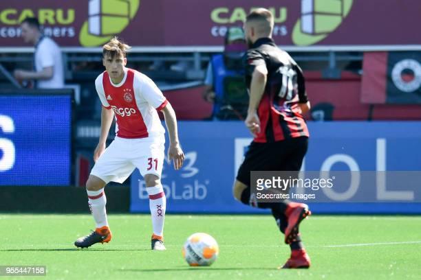 Nicolas Tagliafico of Ajax Stanley Elbers of Excelsior during the Dutch Eredivisie match between Excelsior v Ajax at the Van Donge De Roo Stadium on...