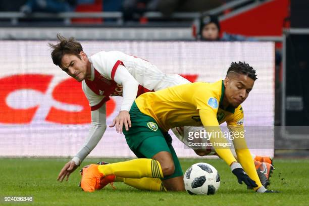 Nicolas Tagliafico of Ajax Tyronne Ebuehi of ADO Den Haag during the Dutch Eredivisie match between Ajax v ADO Den Haag at the Johan Cruijff Arena on...
