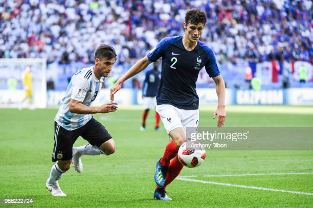 Nicolas Tagliafico of Argentina and Benjamin Pavard of France during the FIFA World Cup Round of 16 match between France and Argentina at Kazan Arena...