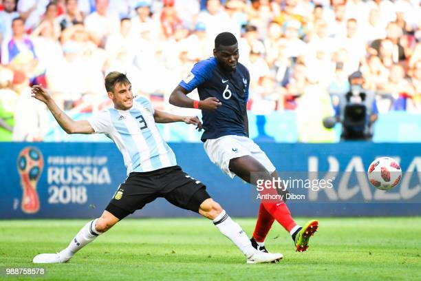 Nicolas Tagliafico of Argentina and Paul Pogba of France during the FIFA World Cup Round of 16 match between France and Argentina at Kazan Arena on...