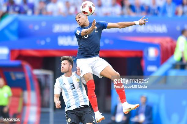Nicolas Tagliafico of Argentina competes with Kylian Mbappe of France during the 2018 FIFA World Cup Russia Round of 16 match between France and...