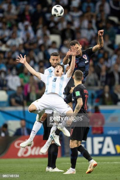 Nicolas Tagliafico of Argentina competes with Mario Mandzukic of Croatia during the 2018 FIFA World Cup Russia group D match between Argentina and...