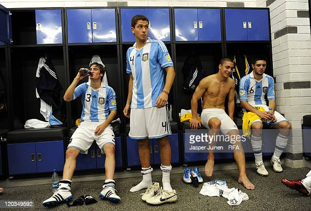 Nicolas Tagliafico of Argentina drinks as he sits with teammates inside the dressing room during the FIFA U20 World Cup Colombia 2011 group F match...