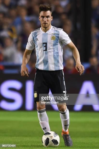 Nicolas Tagliafico of Argentina drives the ball during an international friendly match between Argentina and Haiti at Alberto J Armando Stadium on...