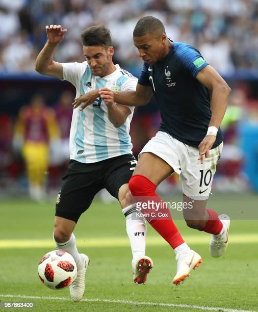 Nicolas Tagliafico of Argentina fouls Kylian Mbappe of France leading to a free kick outside the penalty area during the 2018 FIFA World Cup Russia...