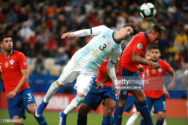 Nicolas Tagliafico of Argentina heads the ball against Eduardo Vargas of Chile during the Copa America Brazil 2019 Third Place match between...