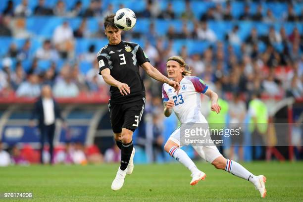 Nicolas Tagliafico of Argentina is challenged by Ari Skulason of Iceland during the 2018 FIFA World Cup Russia group D match between Argentina and...