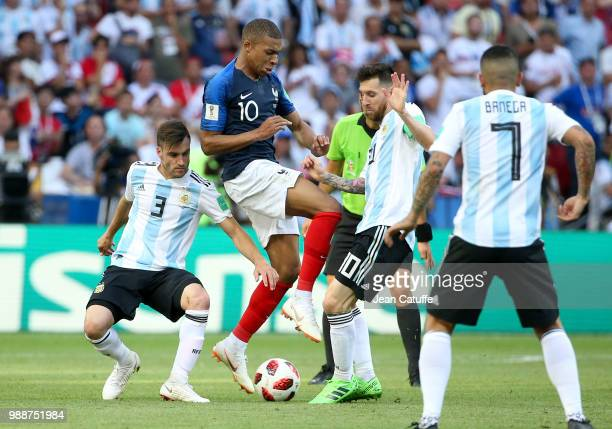 Nicolas Tagliafico of Argentina Kylian Mbappe of France Lionel Messi of Argentina during the 2018 FIFA World Cup Russia Round of 16 match between...