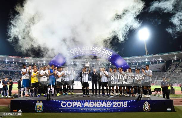 Nicolas Tagliafico of Argentina lifts the Adidas Trophy after winning a friendly match between Argentina and Mexico at Mario Kempes Stadium on...