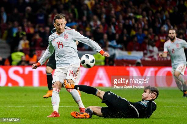 Nicolas Tagliafico of Argentina trips up with Lucas Vazquez of Spain during the International Friendly 2018 match between Spain and Argentina at...