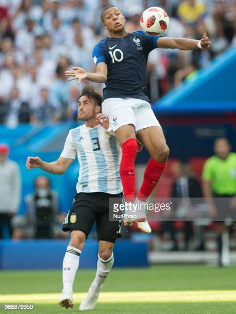 Nicolas Tagliafico of Argentina vies Kylian Mbappe of France during the 2018 FIFA World Cup Russia Round of 16 match between France and Argentina at...