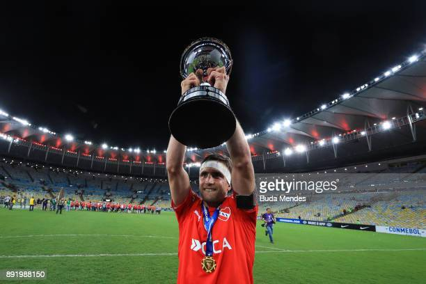 Nicolas Tagliafico of Independiente celebrates with the trophy after victory of the Copa Sudamericana 2017 final between Flamengo and Independiente...