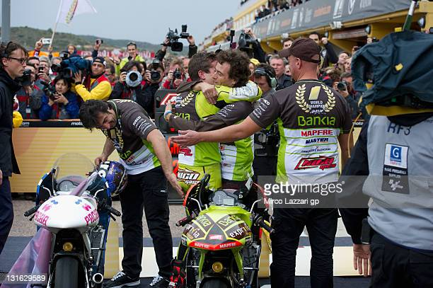 Nicolas Terol of Spain and Aspar Team celebrates with team the victory in 2011 World Championship 125 cc class at the end of the 125 cc race during...