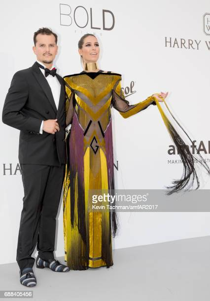 Nicolas Tesic and Laury Thilleman arrive at the amfAR Gala Cannes 2017 at Hotel du CapEdenRoc on May 25 2017 in Cap d'Antibes France