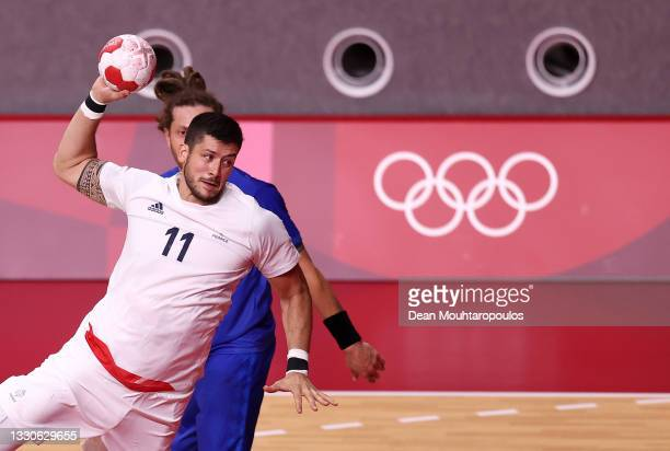 Nicolas Tournat of Team France shoots at goal during the Men's Preliminary Round Group A match between Brazil and France on day three of the Tokyo...