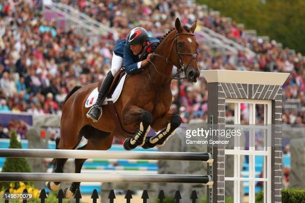 Nicolas Touzaint of France riding Hildago de L'ile in action in the Show Jumping Equestrian event on Day 4 of the London 2012 Olympic Games at...