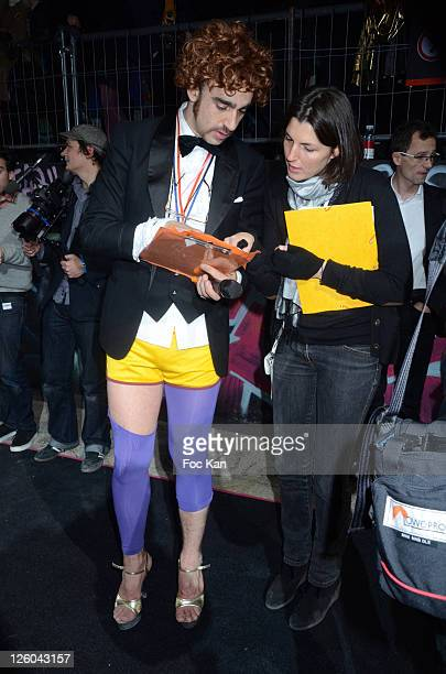Nicolas Ullmann and a guest attend the 'High Heel Race' Hosted by Sarenza Shoes at the Piscine Molitor on December 3 2010 in Paris France