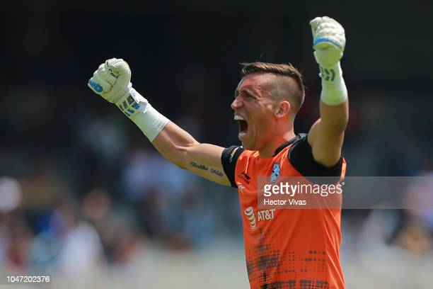 Nicolas Vikonis goalkeeper of Puebla celebrates the own goal scored by Pablo Barrera of Pumas during the 11th round match between Pumas UNAM and...