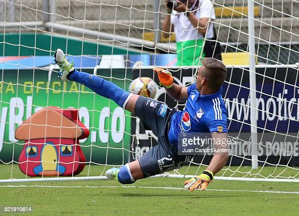 Nicolas Vikonis of Millonarios fails to stop a penalty by Fabian Sambueza of Cai during a match between Deportivo Cali and Millonarios as part of...