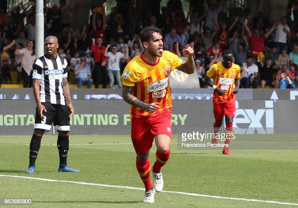 Nicolas Viola of Benevento Calcio celebrates after scoring the 11 goal beside the disappointment of Caetano Samir of Udinese Calcio during the serie...