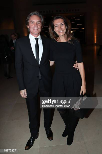 Nicolas Vix and his companion AnneClaire Coudray attend the Grand Dinner of the Louvre on November 19 2019 in Paris France