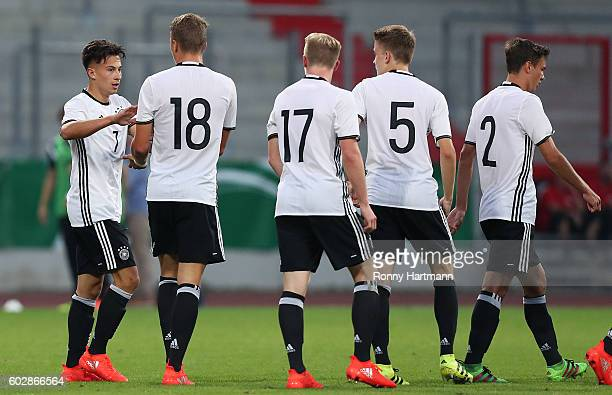 NicolasGerrit Kuehn of Germany celebrates after scoring his team's opening goal with JannFiete Arp Dennis Jastrzembski Jan Boller and Alexander Nitzl...