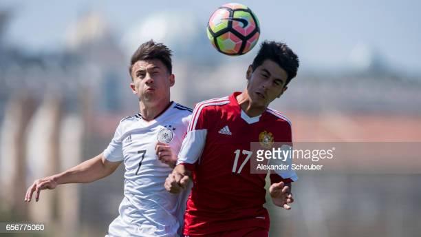 NicolasGerrit Kuehn of Germany challenges Aram Khamoyan of Armenia during the UEFA U17 elite round match between Germany and Armenia on March 23 2017...