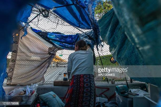 TOPSHOT Nicole 40 yearsold watches the traffic on Freeway 110 from inside her tent over the bridge during the novel Coronavirus COVID19 pandemic in...