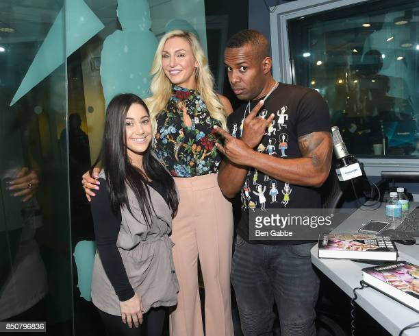 Nicole Adamo and professional wrestler Charlotte Flair visit 'The Whoolywood Shuffle' hosted by DJ Whoo Kid on SiriusXM's Shade 45 at SiriusXM...