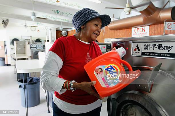 Nicole Alcaraz pours Tide laundry detergent into a laundry machine on March 13 2012 in Miami Florida It was recently reported that the theft and...