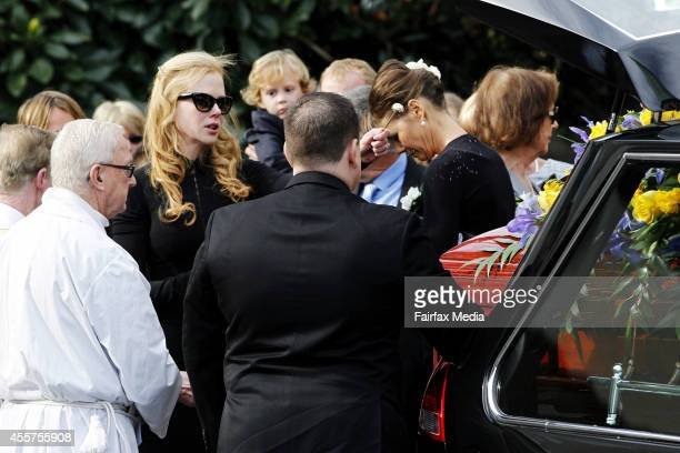 Nicole and Antonia Kidman attend the funeral service of their father Antony Kidman at St Francis Xavier Church in Lavender Bay on September 19 2014...