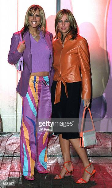 Nicole and Natalie Appleton of the band All Saints attend a launch party for Donatella Versace's new perfume February 19 2001 in London England