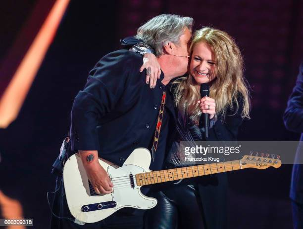 Nicole and the member of the band Olsen Brothers during the television show 'Willkommen bei Carmen Nebel' on April 8 2017 in Magdeburg Germany