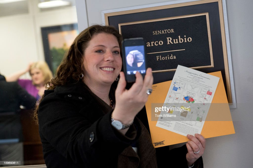 Nicole Anderson of Santa Rosa Beach, Fla., takes a picture of herself after picking up her inauguration tickets from the office of Sen. Marco Rubio, R-Fla., in Hart Building.