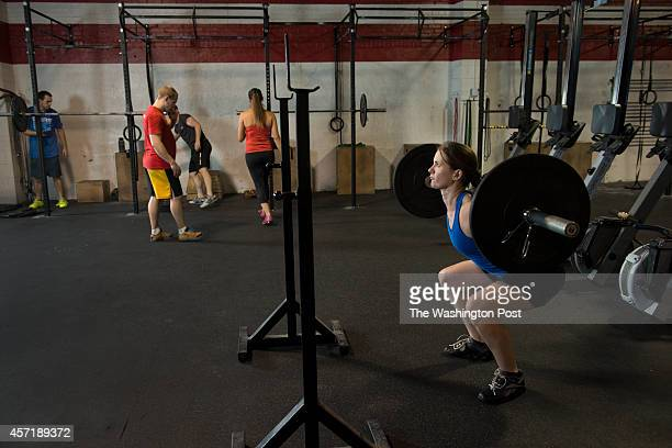 Nicole Andress during an Olympic weightlifting class at District CrossFit SW in Washington DC on October 7 2014 Story about how strong body types are...