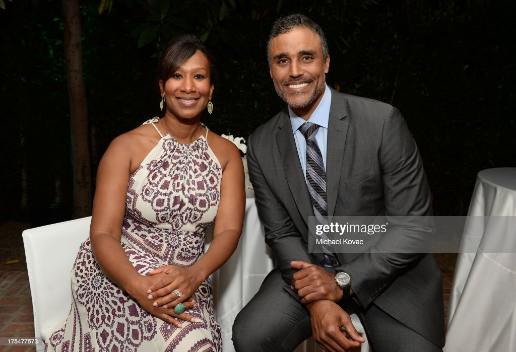 Nicole Avant Sarandos (L) and Rick Fox attend the 87th birthday celebration of Tony Bennett and fundraiser for Exploring the Arts, the charity organization founded by Mr. Bennett and wife Susan Benedetto, hosted by Ted Sarandos & Nicole Avant Sarandos among celebrity friends and family on August 3, 2013 in Beverly Hills, California.
