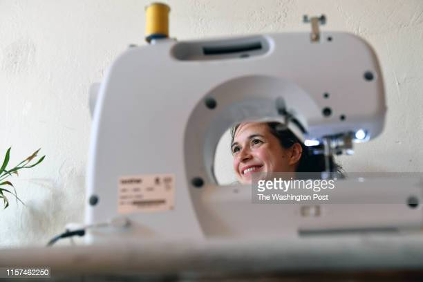 Nicole Barba works on sewing pockets into a dress she brought to the Sew Queer class July 15 2019 in Washington DC Molly Stratton who identifies as...