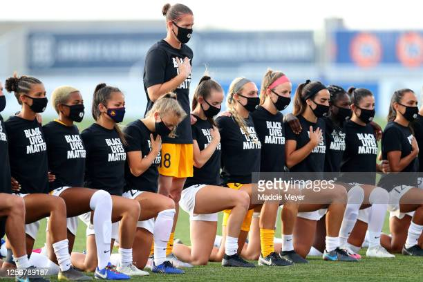 Nicole Barnhart of the Utah Royals FC stands as others teammates kneel during the national anthem prior to the quarterfinal match against the Houston...