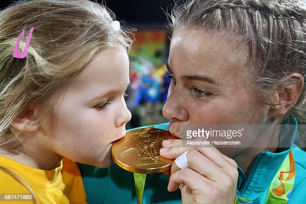 Nicole Beck of Australia kisses her Gold medal with her daughter Sophie Beck after the medal ceremony for the Women's Rugby Sevens on Day 3 of the...